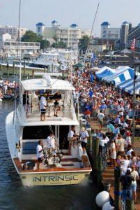 intrinsic yacht with crowd gathered